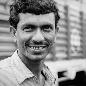 man smiling next to a truck