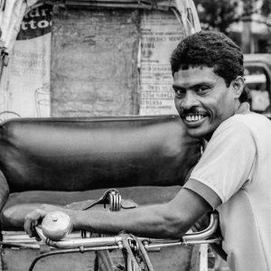 Bashful smile of rickshaw wallah