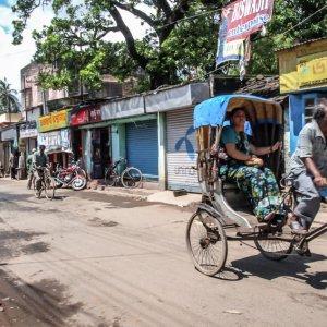 Cycle rickshaw passing