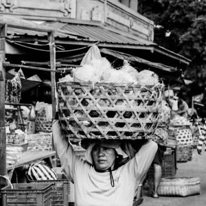 Woman carrying big basket