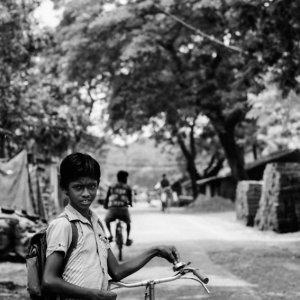 Boy standing by roadside