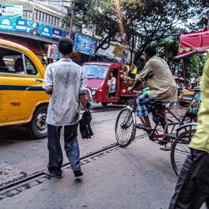 People crossing busy street