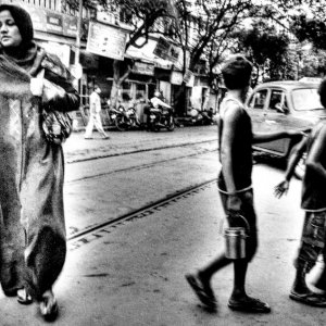 Woman and boys crossing street