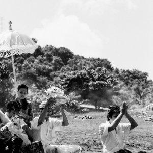 Men praying on beach in Kusamba