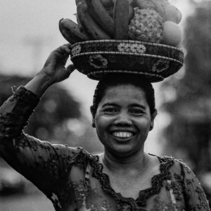 Woman carrying offerings