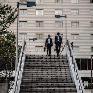 Two businessmen descending