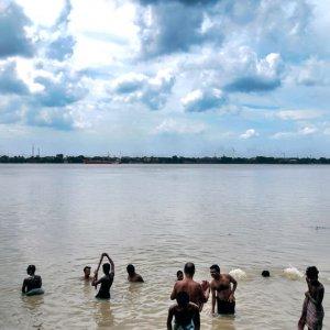 People soaking in Hooghly river