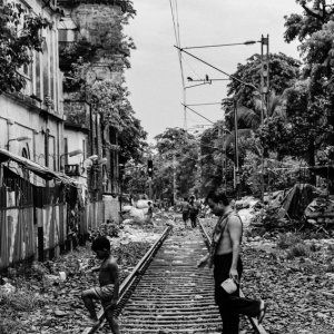 Parent and child crossing railway track