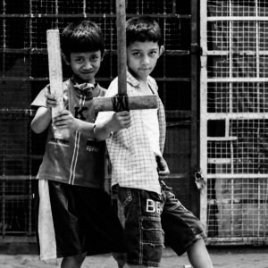 Two boys holding bat