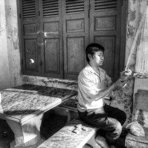 Man repairing fishing net