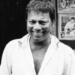 Unbuttoned man's grin