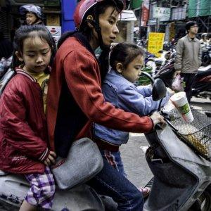Parent and children on same motorbike