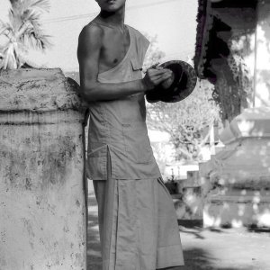 Young monk holding cymbals