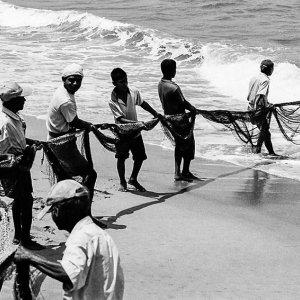 Fishermen dragging fishnet