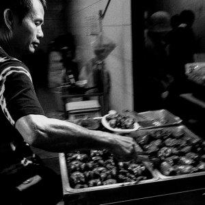 Man working in delicatessen