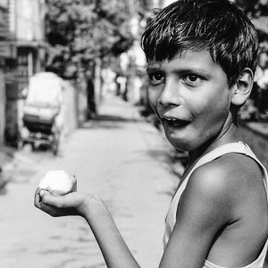 Boy holding mango