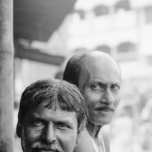 Men in chai stand