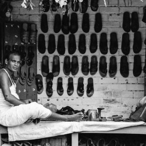 Man selling sandals