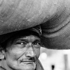 Man putting burden on head