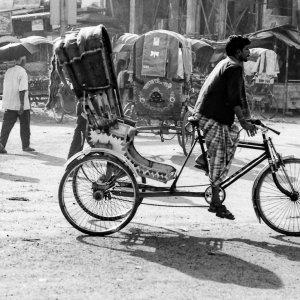 Cycle rickshaw running street