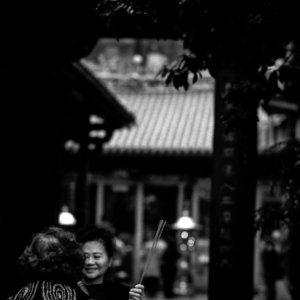 Two women standing talking in Longshan Temple