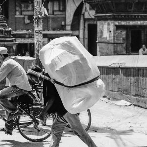 Man carrying burden with a namlo