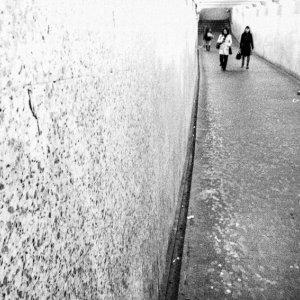 man playing in pedestrian subway