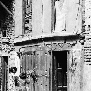 Girls in front of wooden door
