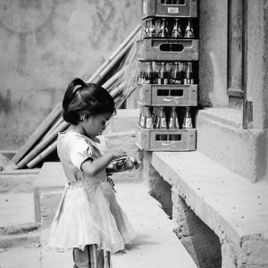 Little girl in front of general store