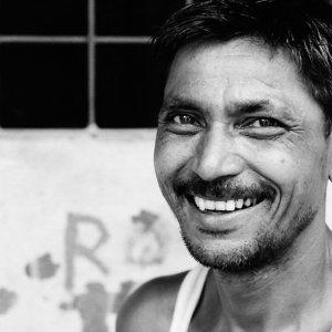 Man with stubble raising smile
