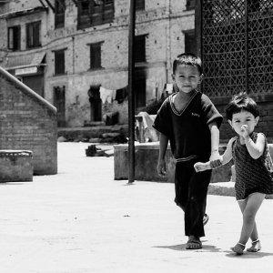 Sibling walking hand in hand