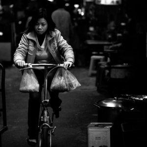 Woman pedaling bicycle