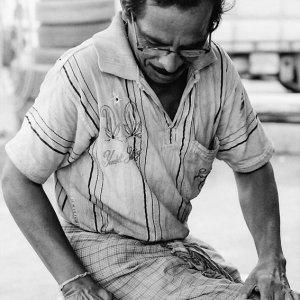 Man making Roti