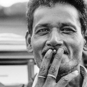 Cigarette between his fingers