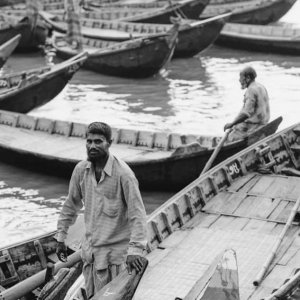 Wharf jammed with wooden boats