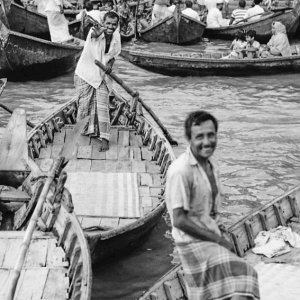 Happy oarsmen on wooden boat