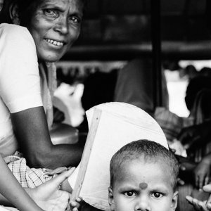 Older woman and little kid on truck
