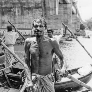 Oarsmen holding bamboo oar