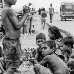 Children playing by roadside