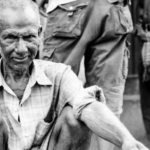 Old laborer resting