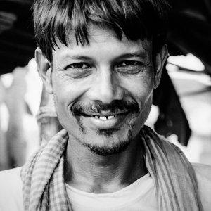 Man grinning a ghastly smile
