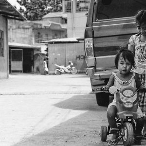Little girl riding tricycle
