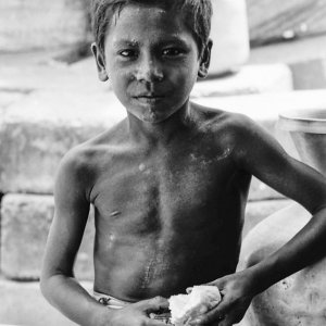 Boy holding a piece of bread