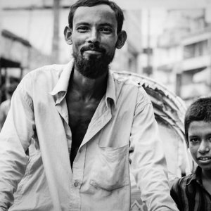 Rickshaw wallah and boy