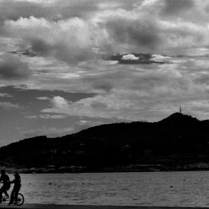 Silhouettes on bicycle