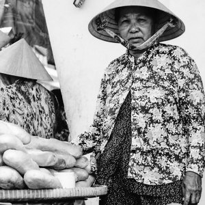 Woman selling baguette