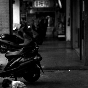 Kid crouching in dim passage
