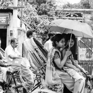 Parent and child on cycle rickshaw