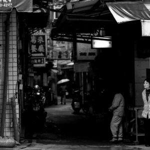 Woman standing in corner of street
