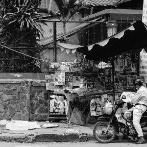 Motorbike in front of kiosk